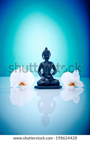 Buddah with white orchis Wellness and Spa Image, works perfect for advertising Health and Beauty, Spirituality or Massage.