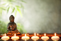Buddha and candles, religious concept.