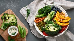 Buddha bowl of mixed grilled vegetables and legumes. Healthy eating concept. Top view