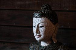 buddha crack face statue