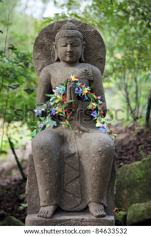 Buddha decorated with flowers - horizontal format