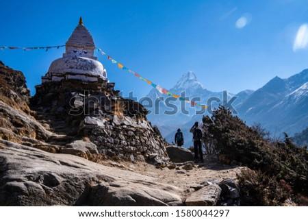 Buddha eyes stupa in Dingboche village, EBC trekking from Tengboche to Dingboche, Nepal