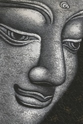 Buddha face on lace fabric. Black and white