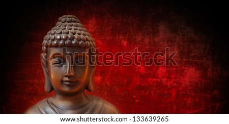 Buddha face on red and black, panorama