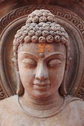 Buddha face , rock engraving