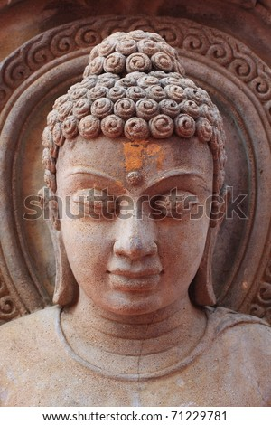 Buddha face , rock engraving