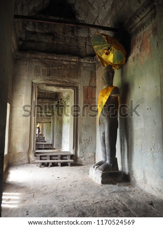 Buddha figure inside the corridor of Angkor Wat, Cambodia #1170524569
