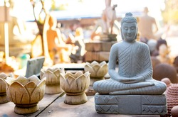 Buddha figurines and shiva. Religious images of various gods of Buddhism and Hinduism. Souvenir shop in Cambodia.