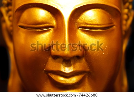 Buddha gold statue close-up #74426680