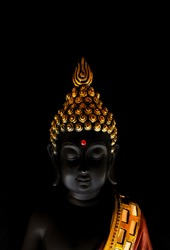 buddha idol isolated over black background.peaceful looking buddha idol resting in a meditative state.background image for meditation,yoga,calm, peace