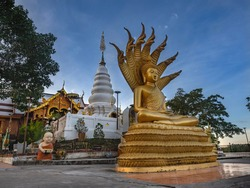 Buddha image with a naga and a pagoda of Buddha's relics at Wat Phra That Doi Leng in Phrae Province, Northern of Thailand. Buddha with Naga Statue called