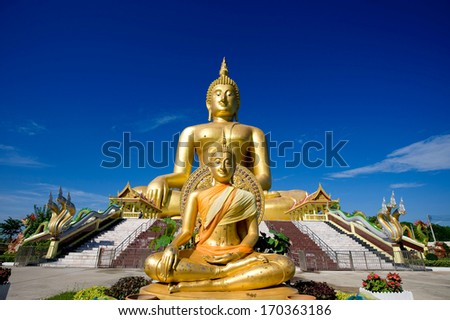 Buddha image with blue sky at Thailand