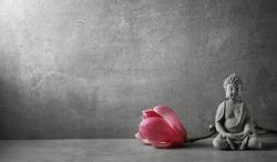 Buddha in meditation with magnolia flower