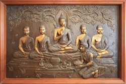 buddha metal copper carving.Mural paintings tell the story about the Buddha's history Buddha sculpture image. Asalha Puja Day. Buddhist All Saints' Day. Golden Buddha statue