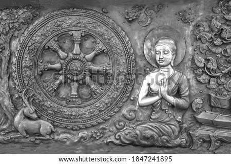Buddha metal copper carving on temple wall in Thailand.Buddha sculpture tell the story about the Buddha's history.