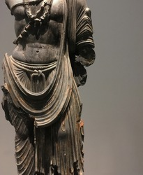 Buddha metal statue layers of cloth . ancient buddhism sculpture