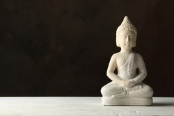 Buddha on white wooden table. Zen concept