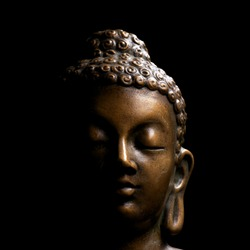 Buddha portrait isolated on black