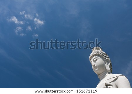 Buddha sculpture, great for Asia travel and religious themes with beautiful blue sky.