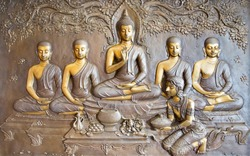 Buddha sculpture image.  Thai style metal carving. and Asalha Puja Day , Buddhist All Saints' Day