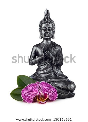 buddha sculpture with orchid blossom