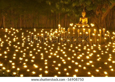 Buddha statue and candle in Chiangmai Thailand
