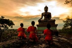 Buddha statue and Novice at sunset in Saraburi, Thailand