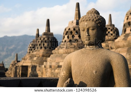 Buddha statue and stupas in Borobudur, or Barabudur, temple Jogjakarta, Java, Indonesia. It is a 9th-century Mahayana temple and the biggest  Buddhist Temple in Indonesia.