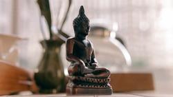 Buddha statue at the tea ceremony close-up