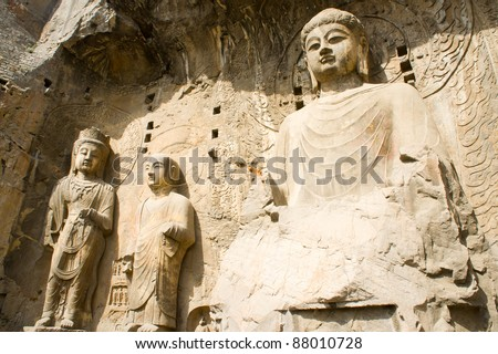 Buddha statue figure in Longmen Grottoes. The Longmen Grottoes with Buddha's figures are located on both banks of the Yi River, near Luoyang City, Henan province, China. Protected by UNESCO.