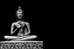 Buddha statue from Thailand.isolated on black background,symbol of religion buddhism.design with copy space add text