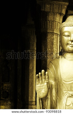 Buddha statue in a Temple as a background