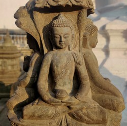 buddha statue in the temple, stone carving, stone buddha statue in Nepal temple.