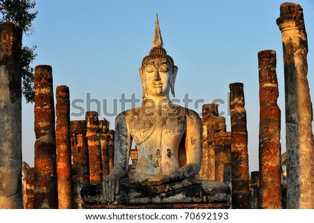 Buddha Statue in Wat Mahathat Temple in Sukhothai Historical park at sunrise, Thailand