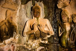 Buddha statue inside of Pandav Leni The Buddha Caves at Nashik, Maharashtra, India. It is ancient caves dating second century A.D. This group of 24 caves located near Nashik.