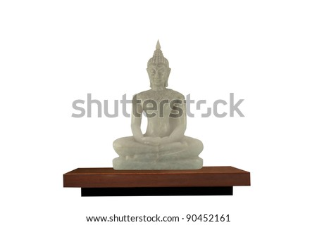 buddha statue made of white marble  in Thai temple on wood shelf isolated
