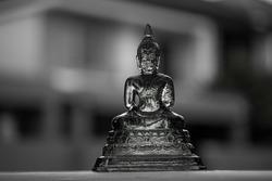 Buddha statue on stone fence
