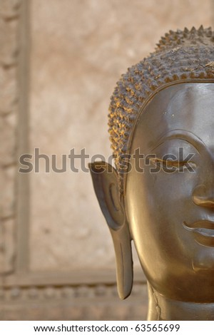 Buddha statue outside a Buddhist temple in Laos