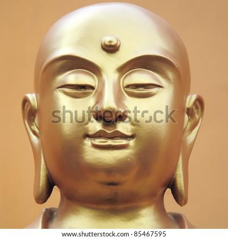 Buddha statue's face close-up