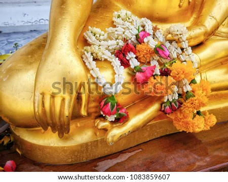 Buddha statue's hand Generally in Thailand, any kinds of decorated in Buddhist church, etc. they are public domain of Buddhism. Selective focus And Close up