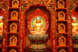Buddha statue sitting on lotusDecorated Inside the Buddha Tooth Relic temple ,Singapore near china town