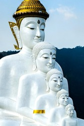 Buddha statue standing tall in the mountains