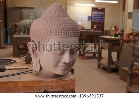 Buddha statue stone head at Stonemason in Siem Reap Cambodia Artisans Angkor