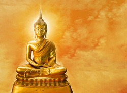 Buddha statue with aura on yellow sky background