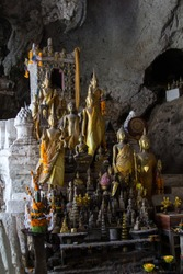 Buddha statues in the lower Pak Ou Cave or the Caves of the thousand buddhas besides the Mekong river 25km upstream of Luang Prabang
