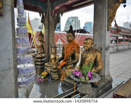 Buddha Statues in Wat Hua Lamphong, Bangkok, Thailand with Bangkok Skyline in the background #1420898756