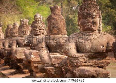Buddha statues stacked along the road, Angkor Wat, Cambodia