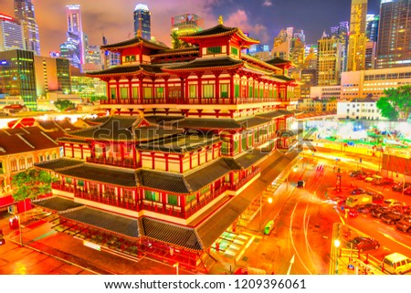 Buddha Tooth Relic Temple of Singapore from aerial view, Southeast Asia. Spectacular buddhist temple in Chinatown district with business district skyline on background by night. #1209396061