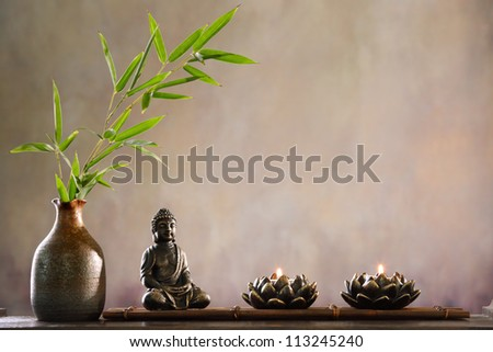 Buddha with candle and bamboo religious concept