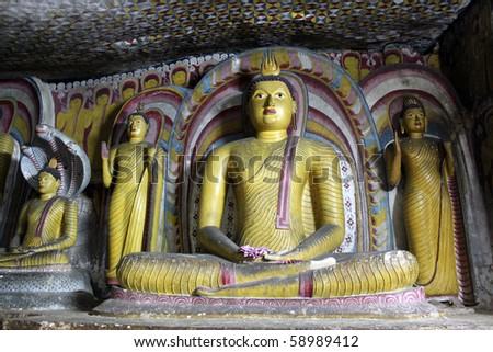 Buddhas at night in cave in Dambulla, Sri Lanka